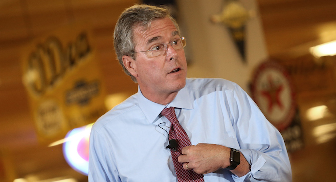 ANKENY, IA - AUGUST 13: Republican presidential candidate Jeb Bush speaks at Dennis Albaugh's Classic Car Barn during the Polk County GOP Annual Summer Sizzle event August 13, 2015 in Ankeny, Iowa. Bush is scheduled to attend the Iowa State Fair tomorrow. (Photo by Win McNamee/Getty Images)