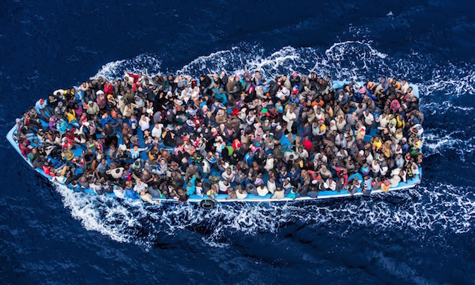 A boatload of refugees rescued 20 miles north of Libya by the Italian Navy during Operation