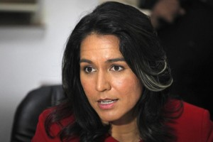 FILE - In this Dec. 27, 2014 file photo, Rep. Tulsi Gabbard, D-Hawaii speaks in Ahmadabad, India. In an unusual alliance, Gabbard and Rep. Austin Scott, R-Ga., have teamed up to urge the Obama administration to stop trying to overthrow Syrian President Bashar Assad and focus all its efforts on destroying Islamic State militants. (AP Photo/Ajit Solanki, File)