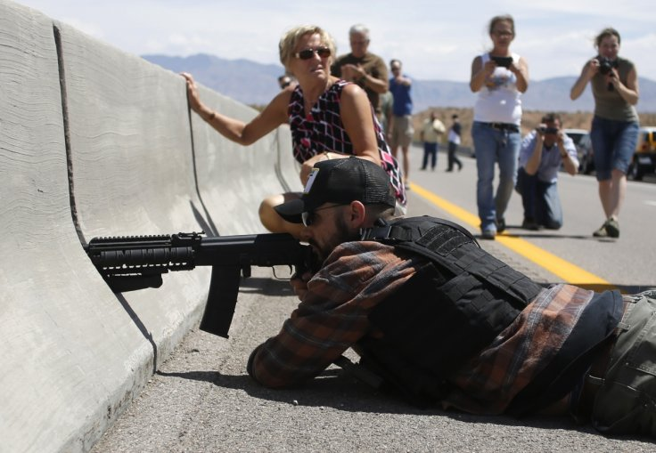 An anti-government protester with an assault rifle defending Cliven Bundy's ranch in 2014Reuters