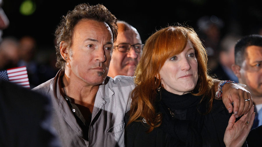 In this November 2, 2008 file photo, Singer Bruce Springsteen and his wife Patti Scialfa listen as then-Democratic presidential nominee Barack Obama speaks during a campaign rally at the Cleveland Mall in Cleveland, Ohio.