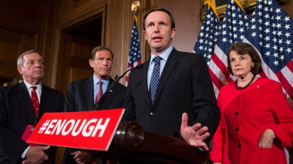 """Senator Chris Murphy (centre) said Congress could not remain """"this out of step"""" with the views and values of the American people for long"""