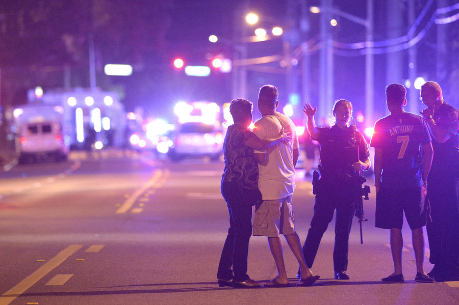 Orlando police officers direct family members away from a shooting at a nightclub in Orlando,