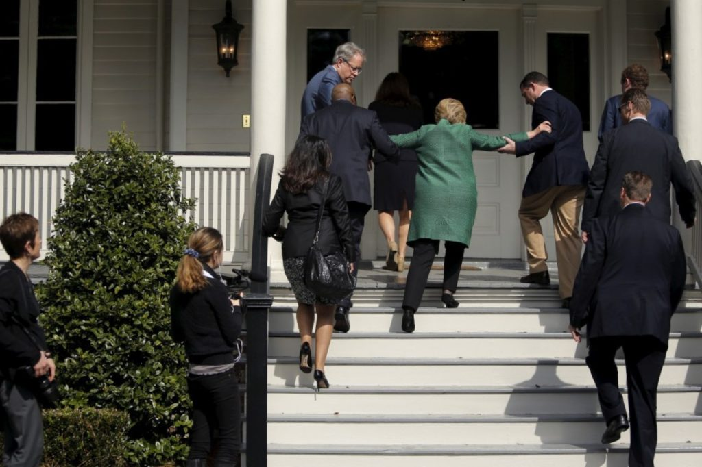 Hillary Clinton loses her balance briefly as she arrives for a tour of SC STRONG, a home for ex-offenders and substance abusers on the grounds of the former Charleston Navy Yard in North Charleston, S.C., on Feb. 24. (Jonathan Ernst/Reuters)