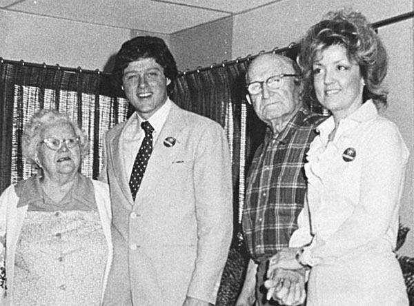Juanita Broaddrick, right, with residents of her Arkansas retirement home and Bill Clinton in April 1978, the same month she says Clinton raped her.