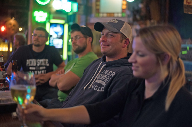 Ken Reed (second from right), 35, of Derry, Pa., watches the presidential debate at the Tin Lizzy, a 270-year-old tavern in Youngstown, Pa.Photo: Justin Merriman
